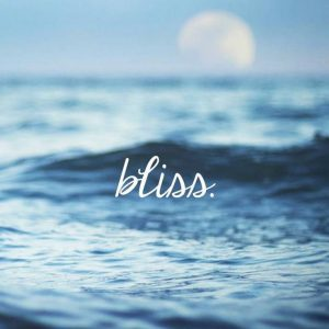 photo of the ocean with the word bliss on it