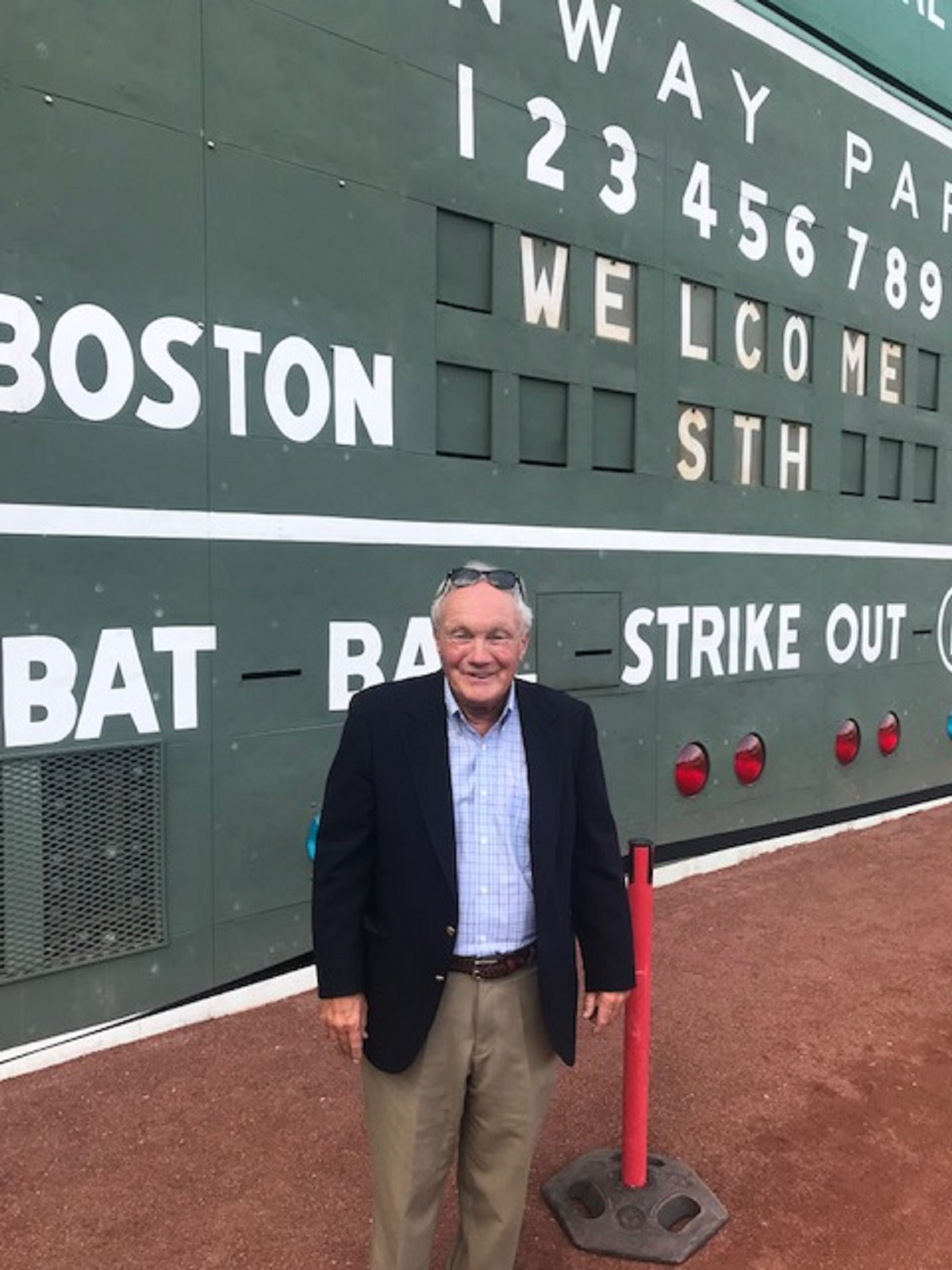 """Andy by the """"Green Monster"""" scoreboard"""