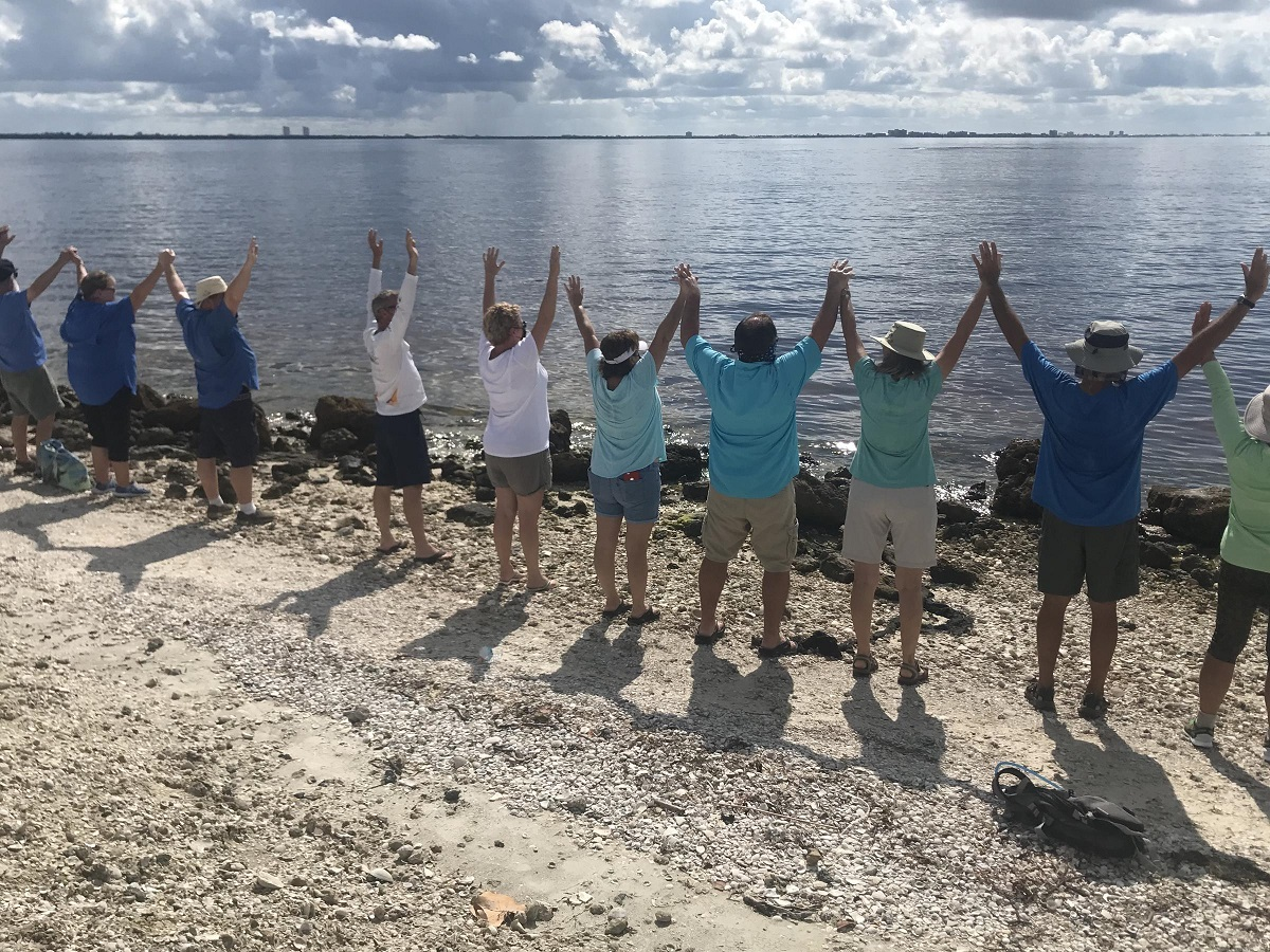Hundreds of people - family, friends, strangers - took to the Sanibel Causeway Islands to lock hands and stand together united in drawing attention to ongoing water quality issues.